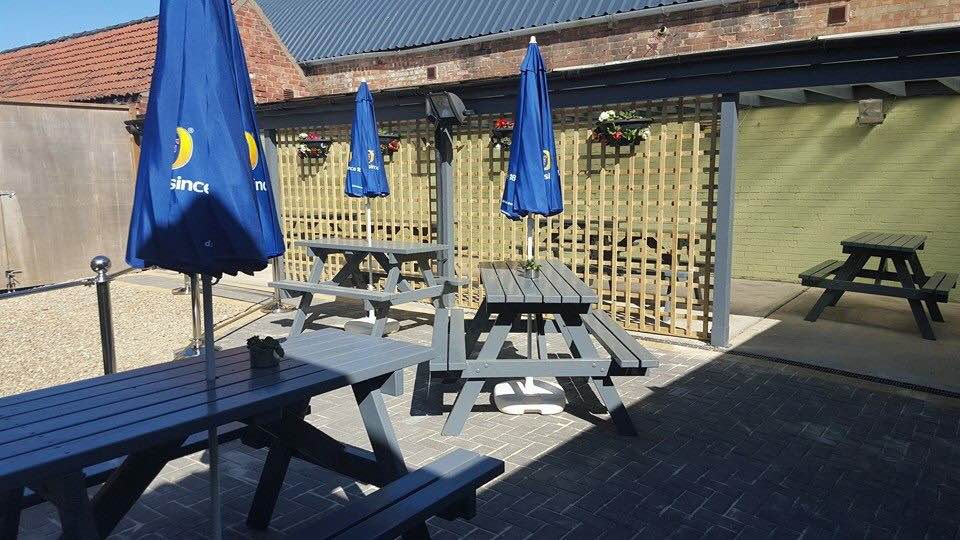 OUTDOOR SEATING AT THE REAR OF THE BAR