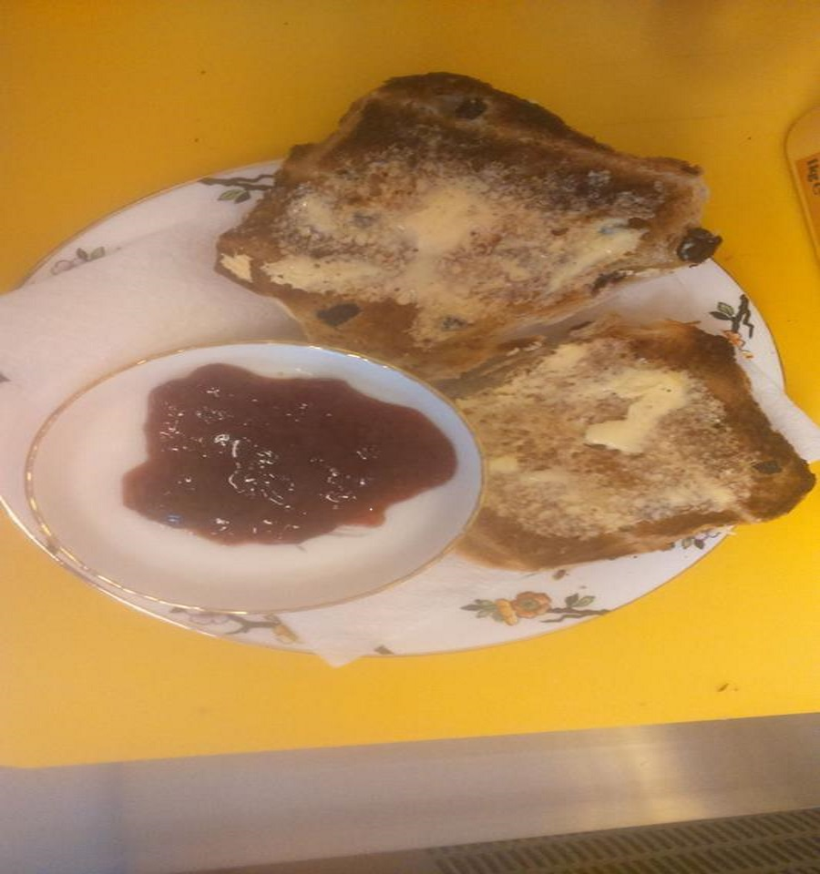 TOASTED BUTTERED HOT CROSS BUNS AND JAM