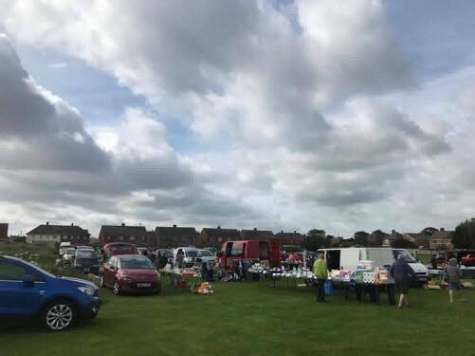 SELLERS AND BUYERS ENJOYING A DAY AT THE CAR BOOT